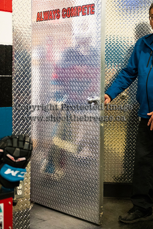 KELOWNA, CANADA - DECEMBER 7:  The reflection of Roman Basran #30 of the Kelowna Rockets  as he stands in the dressing room prior to second period against the Victoria Royals on December 7, 2018 at Prospera Place in Kelowna, British Columbia, Canada.  (Photo by Marissa Baecker/Shoot the Breeze)