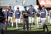 ANAHEIM, CA - JUNE 06:  The Seattle Mariners warm up before batting practice during the game against the Los Angeles Angels of Anaheim on Wednesday, June 6, 2012 at Angel Stadium in Anaheim, California. The Mariners won the game 8-6. (Photo by Paul Spinelli/MLB Photos via Getty Images)