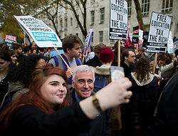 © Licensed to London News Pictures. 04/11/2015. London, UK.   JOHN MCDONNELL poses for a selfie before speaking as Thousands of students take part in a demonstration in central London against tuition fees. The rally which starts outside the University of London Union, will feature a speech from Shadow Chancellor John McDonnell.  Photo credit: Ben Cawthra/LNP