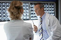 Doctors Discussing brain scan Images