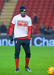 LIVERPOOL, ENGLAND - Sunday, December 13, 2015: Liverpool's Divock Origi warms-up before the Premier League match against West Bromwich Albion at Anfield. (Pic by James Maloney/Propaganda)
