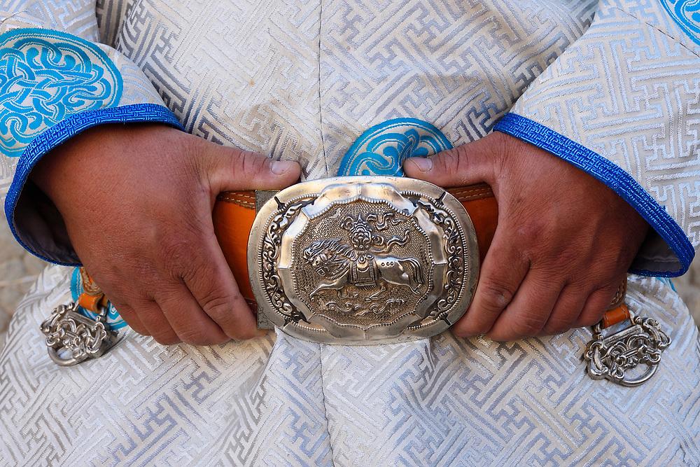 Mongolian Shepherd Ge Ri Li Ao De and his belt buckle, Inner Mongolia, China