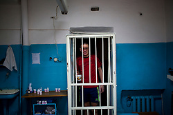 Oleg Ceban takes his daily TB medicine inside the prison in Chisinau.