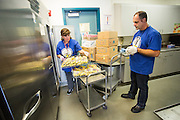 Roger Silveira, Maintenance and Operation Supervisor for <br /> Transportation and Safety works with Russell Middle School's Satellite Kitchen Operator Laura Cisneros to prepare food for students during the California School Employees Association Appreciating Classified Employees event throughout the Milpitas Unified School District in Milpitas, California, on May 21, 2015. (Stan Olszewski/SOSKIphoto)