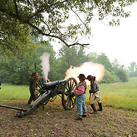 Civil War reenactors fire off a cannon to demostrat how the Civil War was fought during Friday's  Brice's Crossroads Discovery School Day gets underway.