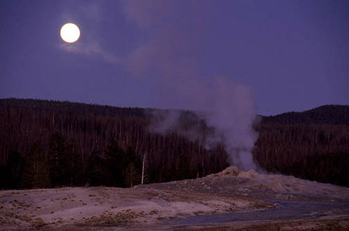 Yellowstone National Park, Moonrise over Old Faithful Geyser.