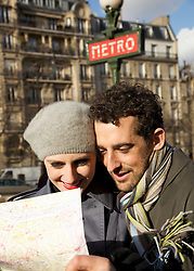 Close up of a couple looking at map, Paris, France