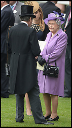 The Queen talks to her racing manager John Warren in the parade ring at Royal Ascot 2013 Ascot, United Kingdom,<br /> Thursday, 20th June 2013<br /> Picture by Andrew Parsons / i-Images