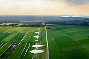 Nederland, Utrecht, Eemnes, 27-08-2013; Arkemheen-Eemland, polderlandschap tussen Eemnes en Spakenburg, een van de laatste open polderlandschappen in de Randstad. De dijk in de Eemnesserpolder heeft wielen, restanten van vroegere dijkdoorbraken<br /> Polder landscape between Utrecht and Amsterdam. <br /> The dike in Eemnesser Polder show  'wheels', remnants of former dike breaches.<br /> luchtfoto (toeslag op standaard tarieven);<br /> aerial photo (additional fee required);<br /> copyright foto/photo Siebe Swart