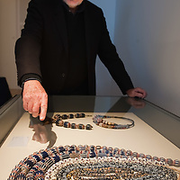 "VENICE, ITALY - DECEMBER 10: Collector Augusto Panini shows part of his collection of Ancient Venetian beads at the press preview of the exhibition ""The Adventure of Glass"" at  Museo Correr on December 10, 2010 in Venice, Italy. After nearly thirty years Correr Museum is hosting a prestigious exhibition in celebration of over a thousands years history of glass in Venice and the Lagoon"