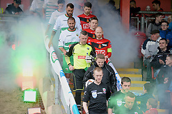NEWTOWN, WALES - Saturday, May 2, 2015: The New Saints' captain Paul Harrison and Newtown's captain Matthew Cook leads their sides out before the FAW Welsh Cup final match at Latham Park. (Pic by Ian Cook/Propaganda)