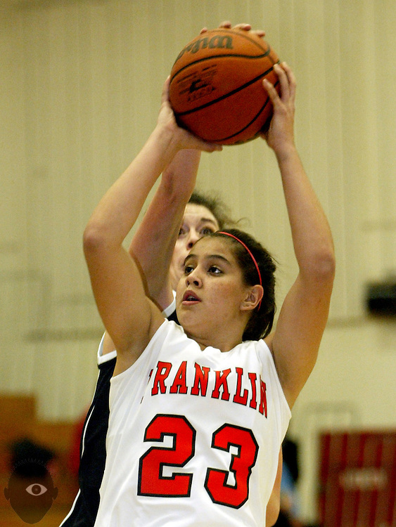 01/07/2010 - Franklin's Shoni Schimmel (23) works to get off a shot as Wilson's Emily Zweber (10).  Franklin beat Wilson 75-51.