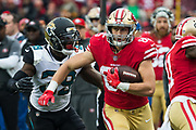 San Francisco 49ers tight end George Kittle (85) carries the ball against the Jacksonville Jaguars at Levi's Stadium in Santa Clara, Calif., on December 24, 2017. (Stan Olszewski/Special to S.F. Examiner)