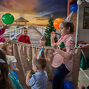 "A child's birthday party at a cafe at Ust-Barguzin, a port town along the shore at Russia's Lake Baikal. Crowned the ""Jewel of Siberia"", Baikal is the world's deepest lake, and the biggest lake by volume, holding 20% of the world's fresh water. In the winter, the lake 31,722 square meter surface is entirely frozen with ice averaging 2 meters thick."