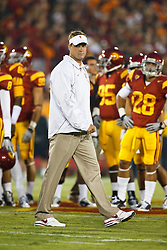 September 11, 2010; Los Angeles, CA, USA;  Southern California Trojans head coach Lane Kiffin watches his team before the game against the Virginia Cavaliers at the Los Angeles Memorial Coliseum. USC defeated Virginia 17-14.