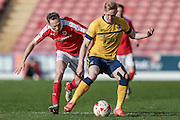 Luke Williams (Scunthorpe United) and Aidan White (Barnsley) during the Sky Bet League 1 match between Barnsley and Scunthorpe United at Oakwell, Barnsley, England on 25 March 2016. Photo by Mark P Doherty.