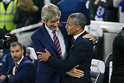 Brighton and Hove Albion manager Chris Hughton greets West Ham United manager Manuel Pellegrini during the Premier League match between Brighton and Hove Albion and West Ham United at the American Express Community Stadium, Brighton and Hove, England on 5 October 2018.