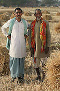 IND.MWdrv04.025.x..Ahraura Village, Uttar Pradesh, India. Bachau Yadav, 42 with his father. Ahraura Village, Uttar Pradesh, India. Revisit with the family, 2004. The Yadavs were India's participants in Material World: A Global Family Portrait, 1994 (pages: 64-65), for which they took all of their possessions out of their house for a family-and-possessions-portrait..