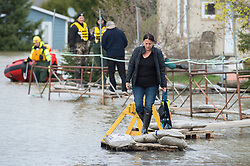 A woman is evacuated from her home by Surete du Quebec police officers in the town of Rigaud, Quebec, Canada., west of Montreal, Monday, May 8, 2017, following flooding in the region. Photo by Graham Hughes /The Canadian Press/ABACAPRESS.COM