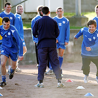 St Johnstone Training...02.02.07<br />Ex Falkirk player Andy Lawrie sprints with team mate Neil Janczyk during training this morning before facing his old side in tomorrow's Scottish Cup tie<br />see story by Gordon Bannerman Tel: 01738 553978 or 07729 865788<br />Picture by Graeme Hart.<br />Copyright Perthshire Picture Agency<br />Tel: 01738 623350  Mobile: 07990 594431