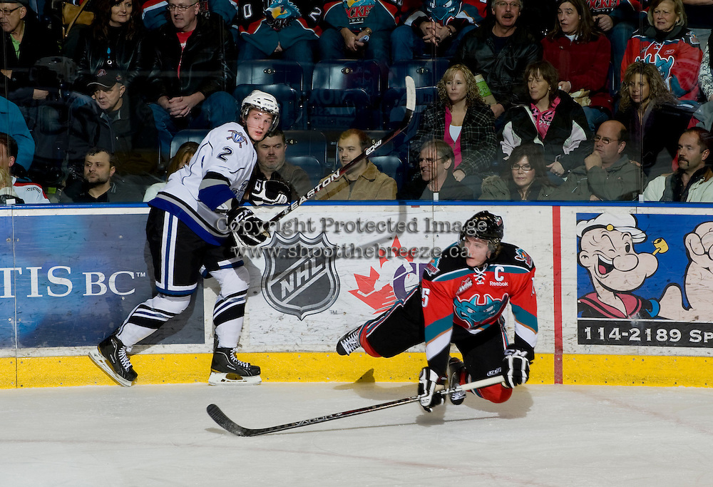 KELOWNA, CANADA, DECEMBER 2: Hayden Rintoul #2 of the Victoria Royals checks Colton Sissons #15 of the Kelowna Rockets as the Victoria Royals visit the Kelowna Rockets  on December 2, 2011 at Prospera Place in Kelowna, British Columbia, Canada (Photo by Marissa Baecker/Shoot the Breeze) *** Local Caption ***