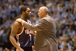 Virginia head basketball coach Dave Leitao talks to first-year Will Harris (1) during the second half against UNC.  The #1 ranked Tar Heels beat the Cavaliers 79-69 to improved to 15-1 overall, 2-0 ACC on January 10, 2007 at the Dean Smith Center in Chapel Hill, NC...<br />
