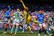 Scott Bain punches the ball clear from a corner during the Ladbrokes Scottish Premiership match between Rangers and Celtic at Ibrox, Glasgow, Scotland on 12 May 2019.