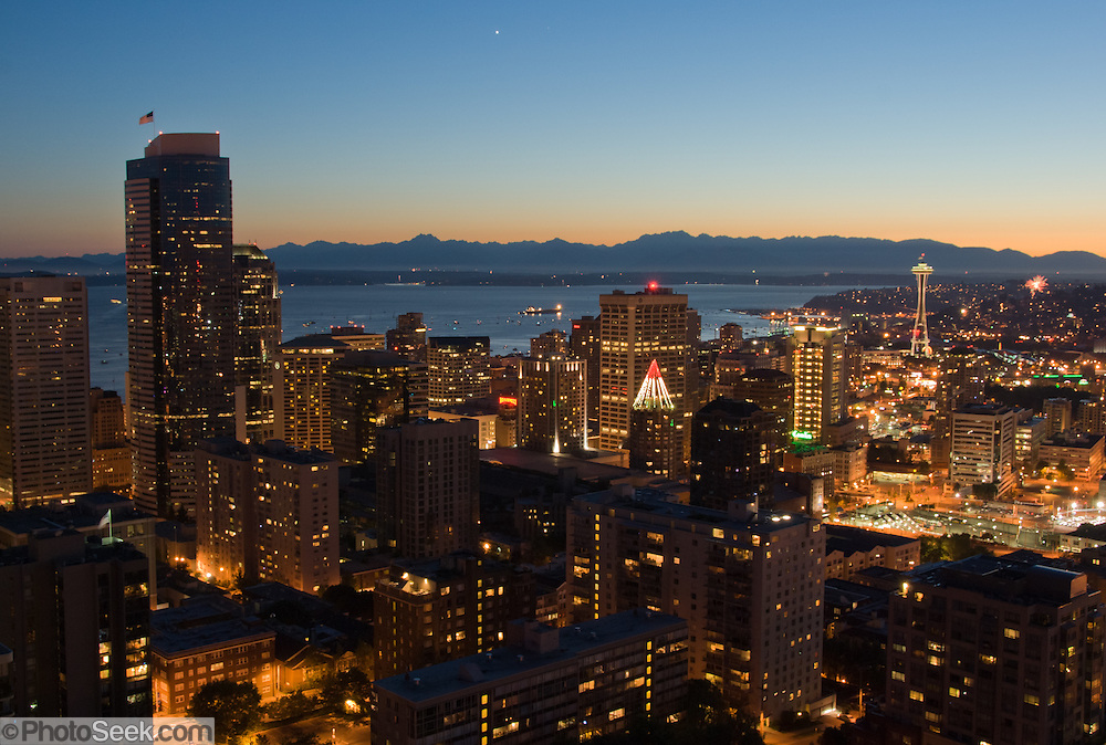 "Downtown Seattle, the Space Needle, Puget Sound and the Olympic Mountains at sunset, on July 4, 2007. Published in ""Light Travel: Photography on the Go"" book by Tom Dempsey 2009, 2010. Photographed by Tom Dempsey from the 33rd floor of First Hill Plaza, 1301 Spring Street, Seattle, Washington."