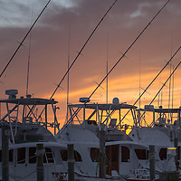 Boats in silhouette against beautiful sunset. Frisco Harbor, NC