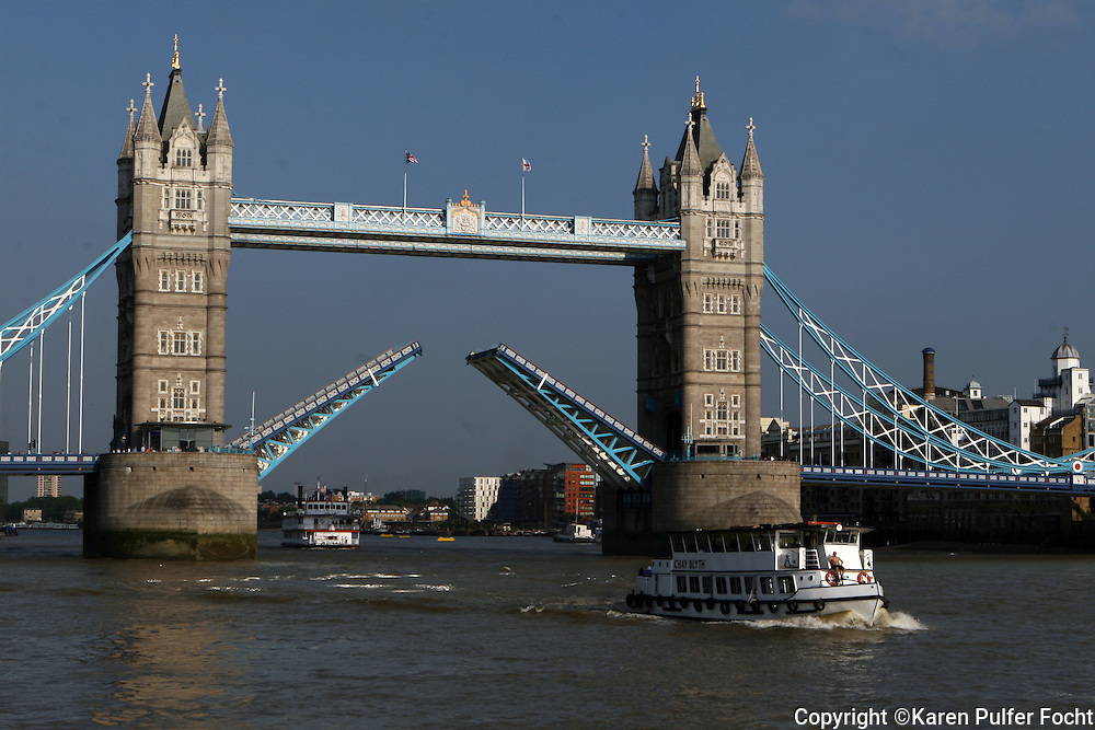 The Tower bridge over the River Thames in London opens as ships come and go. London has experienced unusually sunny and dry weather this summer.