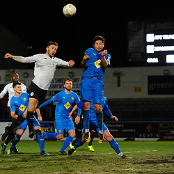 TELFORD COPYRIGHT MIKE SHERIDAN Zak Lilly battles for a header during the FA Trophy Round 1 fixture between AFC Telford United and Leamington at the New Bucks head Stadium on Tuesday, December 17, 2019.<br /> <br /> Picture credit: Mike Sheridan/Ultrapress<br /> <br /> MS201920-034