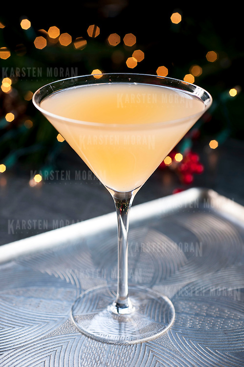 "December 2, 2013 - New York, NY : A selection of holiday cocktails, prepared and styled by Suzanne Lenzer, include the ""Grapefruit-tini,"" a vodka and prosecco-based drink made with grapefruit juice. CREDIT: Karsten Moran for The New York Times"