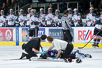 KELOWNA, CANADA - JANUARY 2:  Jeff Thorburn, athletic therapist of the Kelowna Rockets assists Khore Elliott, athletic therapist of the Victoria Royals as they tend to an injured Ben Walker #10 of the Victoria Royals at the Kelowna Rockets on January 2, 2013 at Prospera Place in Kelowna, British Columbia, Canada (Photo by Marissa Baecker/Shoot the Breeze) *** Local Caption ***