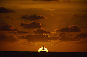 Sailboat at sunset, Waikiki, Oahu, Hawaii<br />