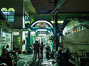 05 JUNE 2016 - BANGKOK, THAILAND: Men gather in front of Masjid Darul Faha, a small mosque in the Muslim majority neighborhood of Ban Krua in Bangkok on the night before the start of Ramadan. Ramadan is the ninth month of the Islamic calendar, and starts on June 6 this year. It is observed by Muslims worldwide as a month of fasting to commemorate the first revelation of the Quran to Muhammad according to Islamic belief. This annual observance is regarded as one of the Five Pillars of Islam. Islam is the second largest religion in Thailand.        PHOTO BY JACK KURTZ