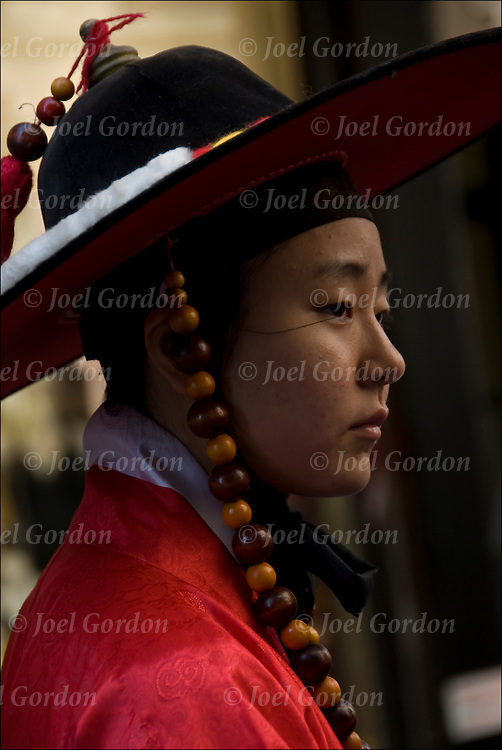 Korean high school student showing her ethnic pride, culture and heritage  in the 30th Annual Korean Harvest Parade in New York City. She is wearing traditional folk regalia / costume when celebrating the harvest.