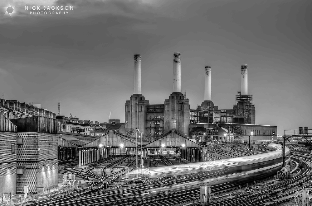 The winding curves of the train and tracks offsets the rigid lego-like structure of the old power station