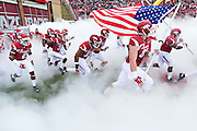 FAYETTEVILLE, AR - OCTOBER 24:  Arkansas Razorback players run onto the field before a game against the Auburn Tigers at Razorback Stadium on October 24, 2015 in Fayetteville, Arkansas.  The Razorbacks defeated the Tigers in 4 OT's 54-46.  (Photo by Wesley Hitt/Getty Images) *** Local Caption ***