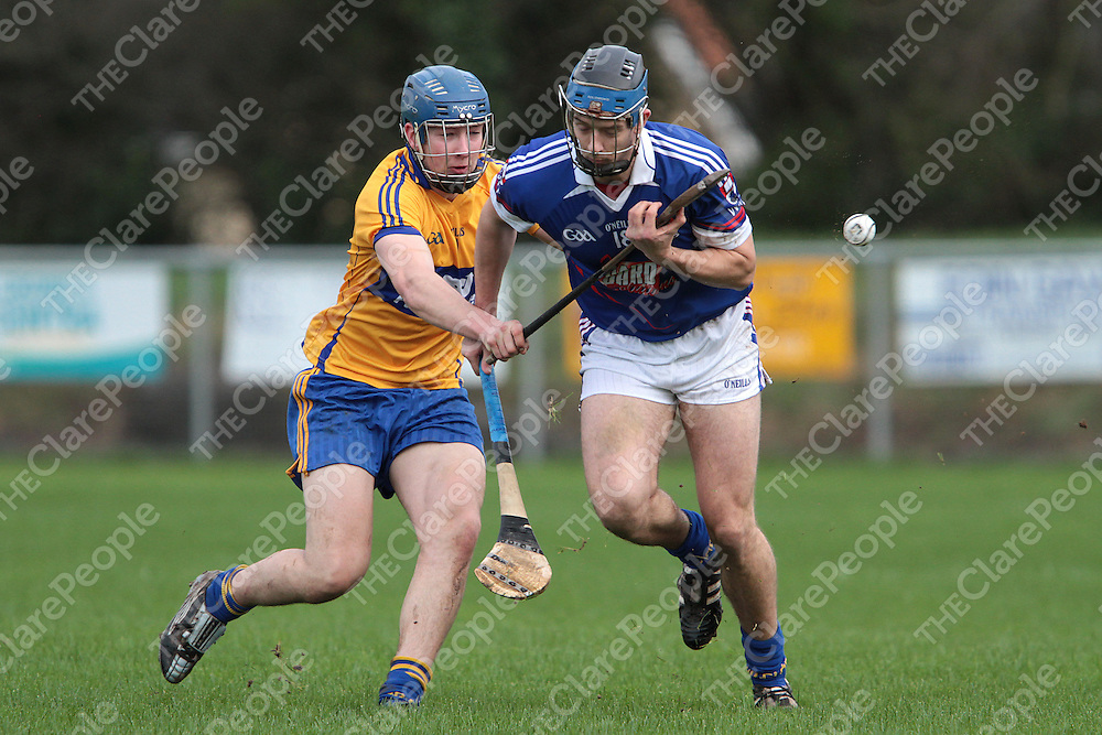 Clare's Daire Keane taps the sliotar away from the grasp of WIT's Luke O'Loughlin in the Waterford Crystal Hurling Tournament @ Sixmilebridge. - Photograph by Flann Howard