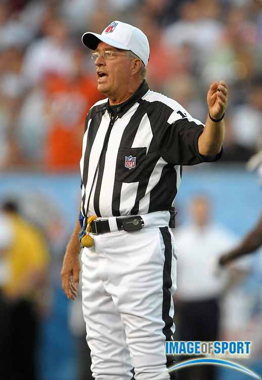 Aug 8, 2010; Canton, OH, USA; Referee Ron Winter (18) makes a call during the preseason game between the Dallas Cowboys and the Cincinnati Bengals at Fawcett Stadium. Photo by Image of Sport