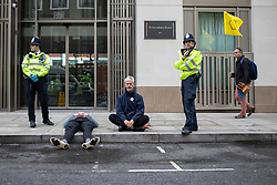 © Licensed to London News Pictures. 08/10/2019. London, UK. Two extinction Rebellion protesters are detained by police near the Home Office. Police continue to attempt to open roads in Westminster on the second day of the protest. Photo credit: George Cracknell Wright/LNP