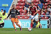 Sheffield United striker Leon Clarke (27) looks to release the ball under pressure from Northampton Town defender (on loan from Barnsley) Lewin Nyatanga (22) during the EFL Sky Bet League 1 match between Northampton Town and Sheffield Utd at Sixfields Stadium, Northampton, England on 8 April 2017. Photo by Dennis Goodwin.