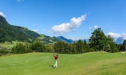 THEMENBILD - Ein Golfspieler am Golfclub Eichenheim mit der Streif und dem Wilden Kaiser als Bergpanorama, aufgenommen am 04. Juli 2017, Kitzbühel, Österreich // A golf player at the Eichenheim Golfclub with the Streif and the Wilder Kaiser as a mountain panorama at Kitzbühel, Austria on 2017/07/04. EXPA Pictures © 2017, PhotoCredit: EXPA/ Stefan Adelsberger
