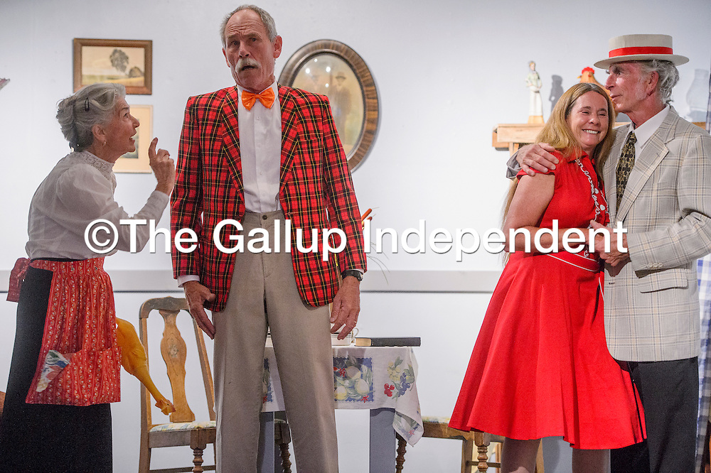 "Carol MacRae, left, George Dobbs, Karen Pettit and Eden Gloria play their parts in a rehearsal for ""Little Nell and the Mortgage Foreclosure"" Wednesday at Old School Gallery in El Morro."