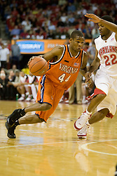 Virginia guard Sean Singletary (44) dribbles past Maryland guard Adrian Bowie (22).  The Maryland Terrapins defeated the Virginia Cavaliers men's basketball team 85-75 at the Comcast Arena in College Park, MD on January 30, 2008.