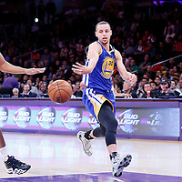 11 April 2014: Golden State Warriors guard Stephen Curry (30) passes the ball past Los Angeles Lakers forward Wesley Johnson (11) during the Golden State Warriors 112-95 victory over the Los Angeles Lakers at the Staples Center, Los Angeles, California, USA.