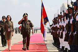 April 25, 2017 - Phnom Penh, Cambodia - General POL SAROEUN, Commander-In-Chief of the Royal Cambodian Armed Forces (RCAF), and DEBORA COMINI, United Nations Resident coordinator, inspect the guard of honour. Cambodia sent the fourth batch of 309 troops, including 25 females, to join a United Nations peacekeeping mission in the conflict-torn West African nation of Mali. (Credit Image: © Sovannara/Xinhua via ZUMA Wire)