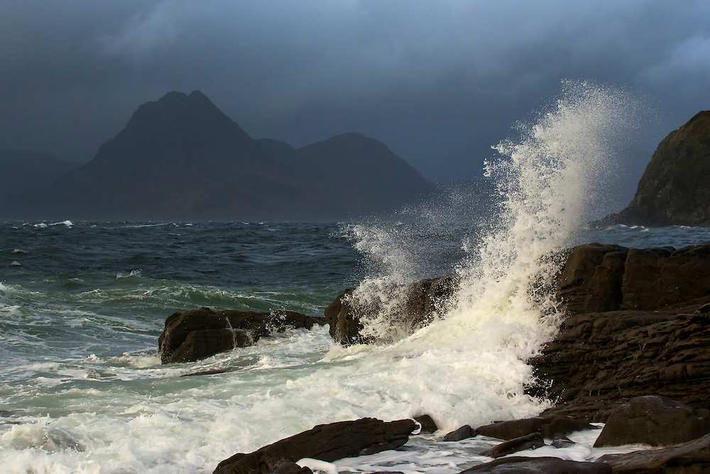 Wave breaking over rocks in stormy weather, Elgol, Isle of Skye, Scotland