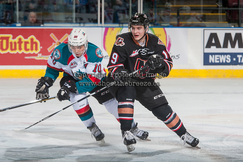 KELOWNA, CANADA - FEBRUARY 1: Andrei Grishakov #19 of the Calgary Hitmen stick checks Nick Merkley #10 of the Kelowna Rockets during first period on February 1, 2017 at Prospera Place in Kelowna, British Columbia, Canada.  (Photo by Marissa Baecker/Shoot the Breeze)  *** Local Caption ***