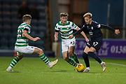 31st October 2018, Kilmac Stadium, Dundee, Scotland; Ladbrokes Premiership football, Dundee v Celtic; Jack Lambert of Dundee takes on James Forrest and Kieran Tierney of Celtic